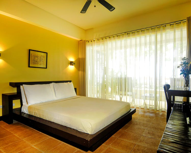 Tagbanua bedroom with  closed thin blinds - 1  bedroom absolute beachfront apartment at Boracay SandCastles The Apartments.
