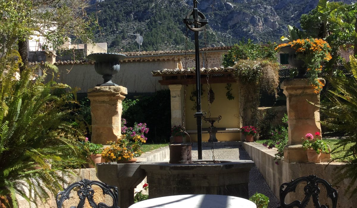 The Salvia well and font with the Tramuntana Mountains in the background