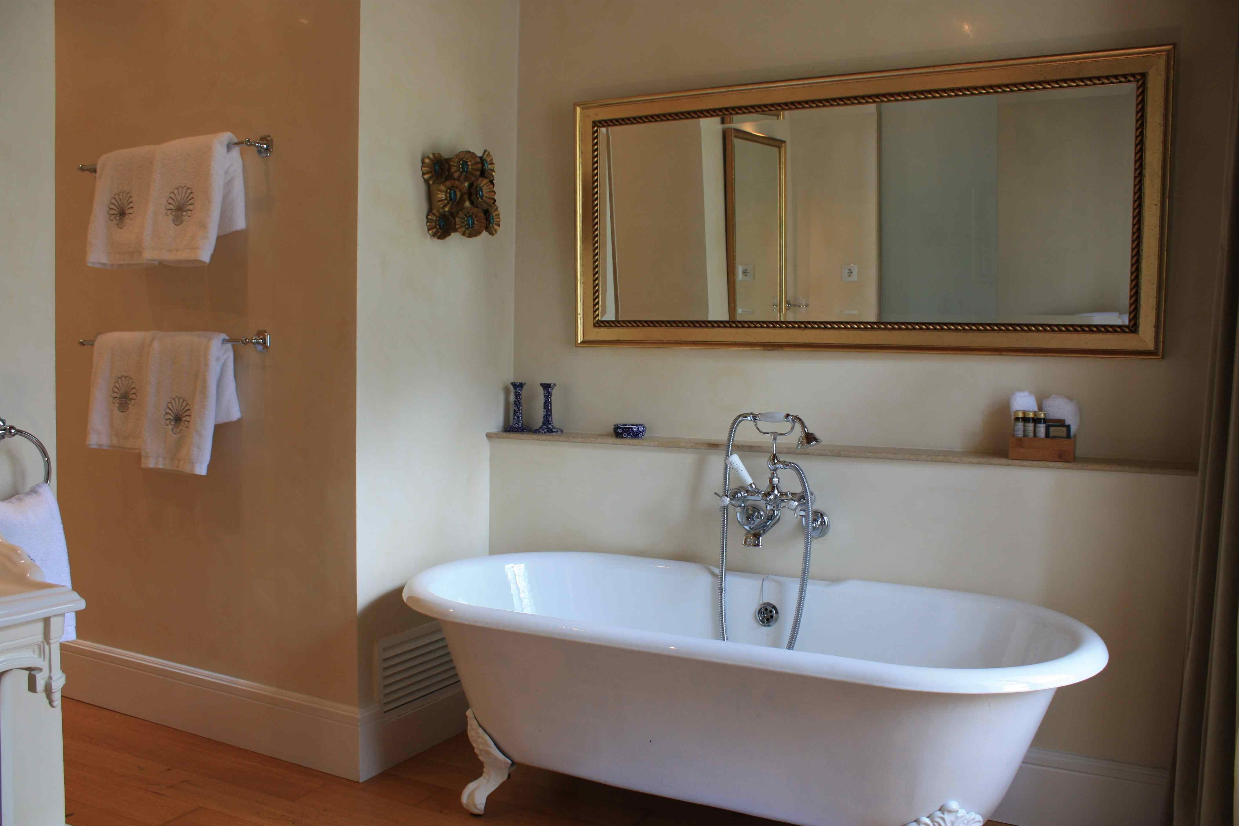 The free standing roll top bath within the Deia Junior Suite