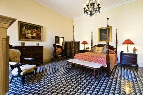 The four poster bed and ornate tile flooring of the 4 roomed Salvia Superior Suite