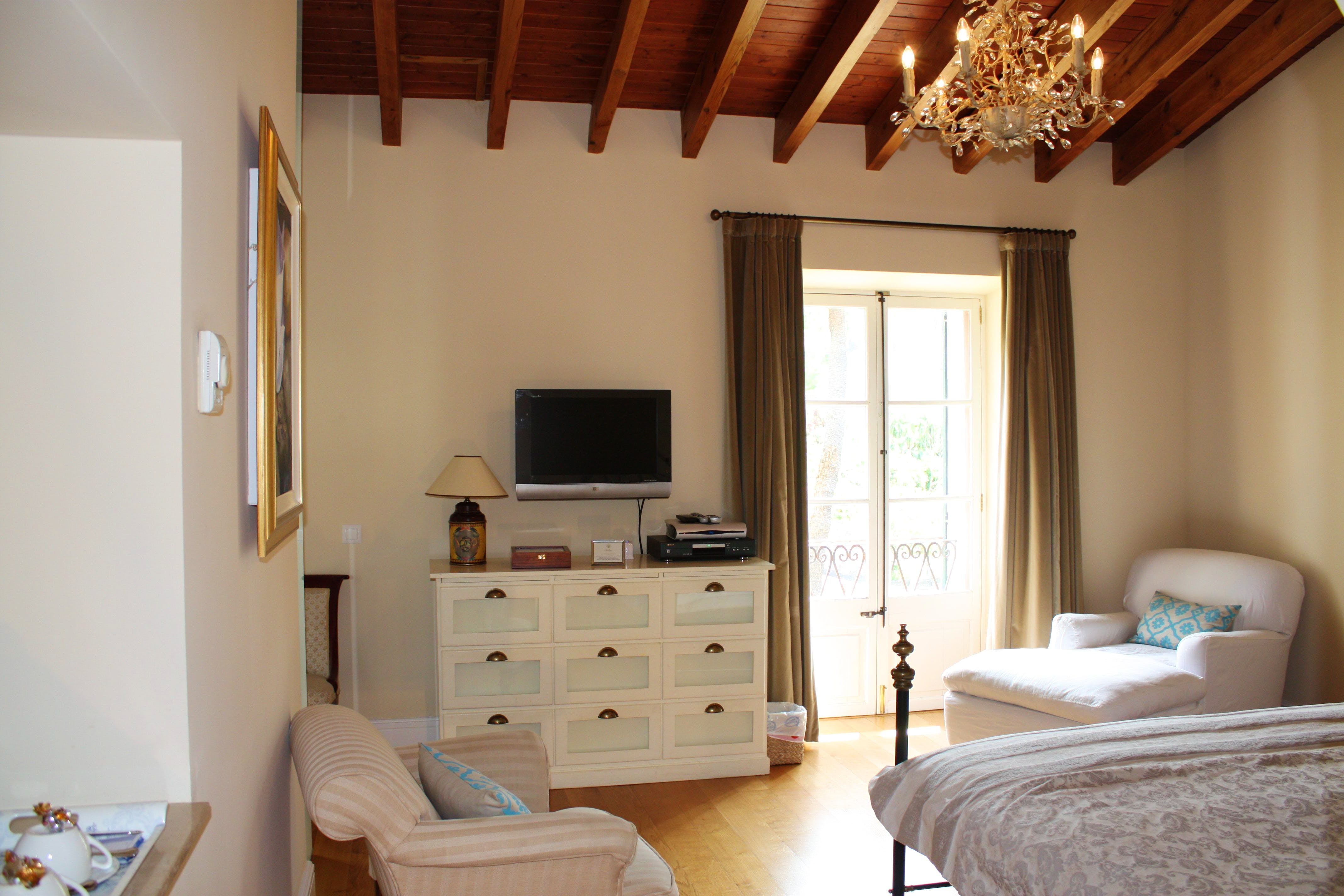 A view of the Deia Junior Suite looking towards the french windows