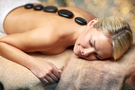 A hot stone massage treatment available to Hotel Guests by appointment