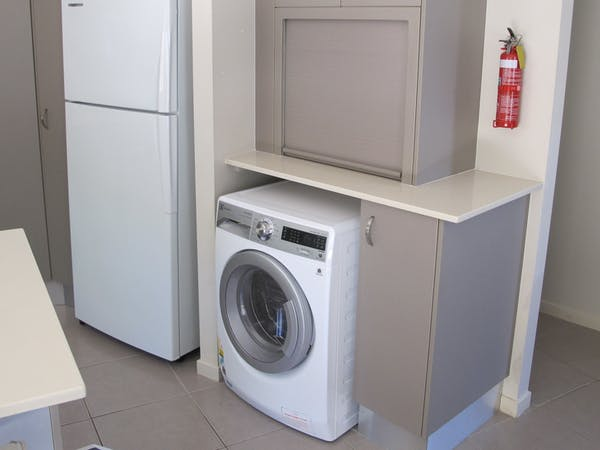 Laundry facilities in Apartment One