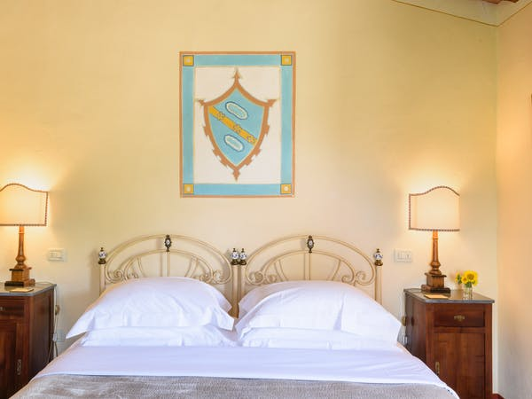 Casa Portagioia Tuscany bed and breakfast , Grilandi double bedroom with views of courtyard and olive groves.