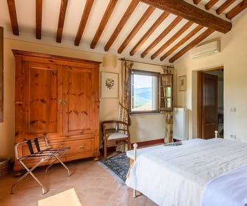 Casa Portagioia Tuscany bed and breakfast ,Funghini suite with double bedroom with views of gardens and surrounding landscape
