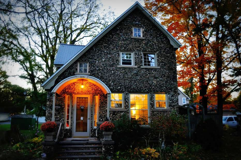 Aberdeen Stone Cottage, front of house on a fall evening