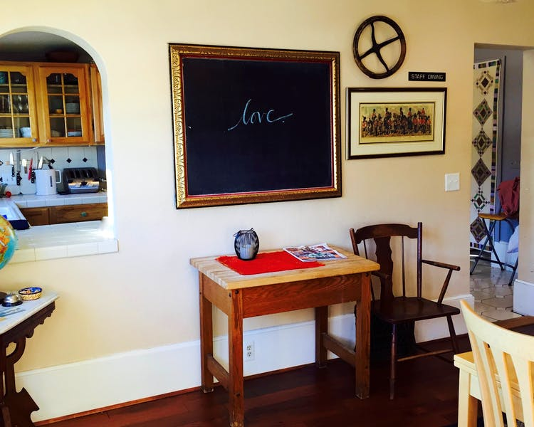 Dining room with chalk board and a view to the kitchen