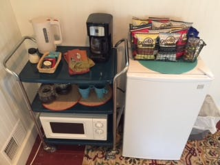 Complimentary snacks, tea, coffee. Microwave and bar bridge