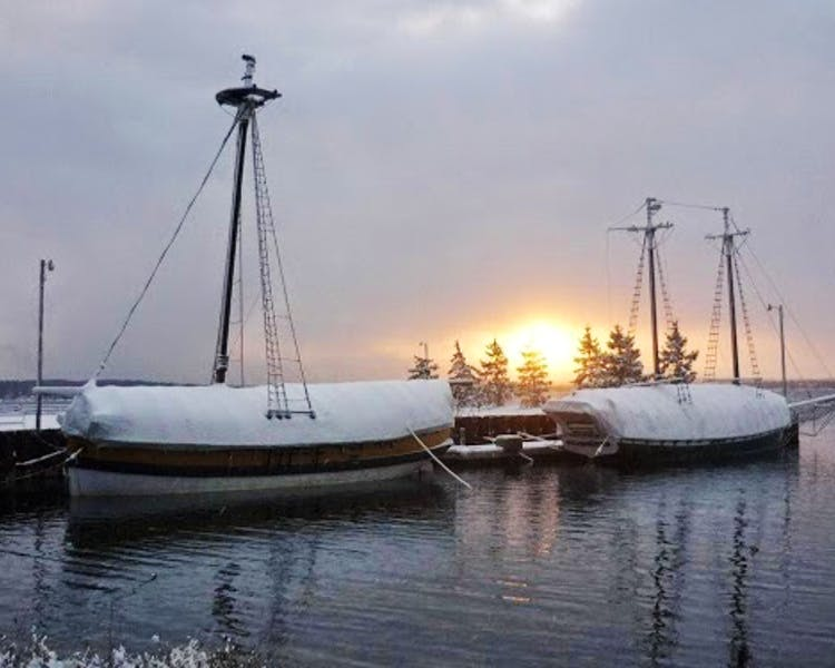 Ships at harbor in winter