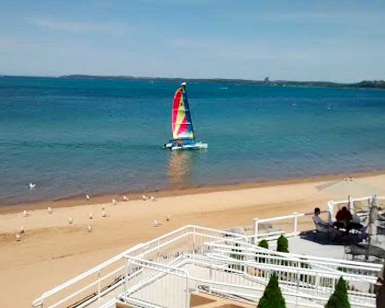 Catamaran sailing on West Bay