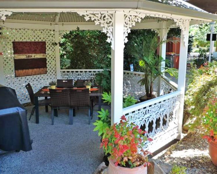 Pergola with gas bbq and outdoor setting