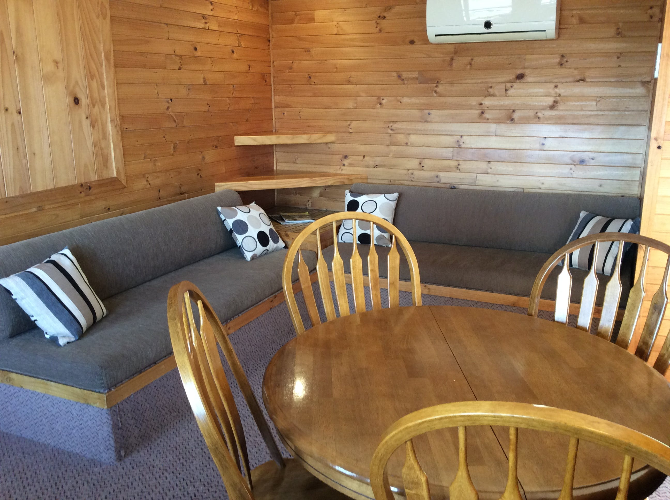Dining and lounge area in one bedroom self-contained cottage