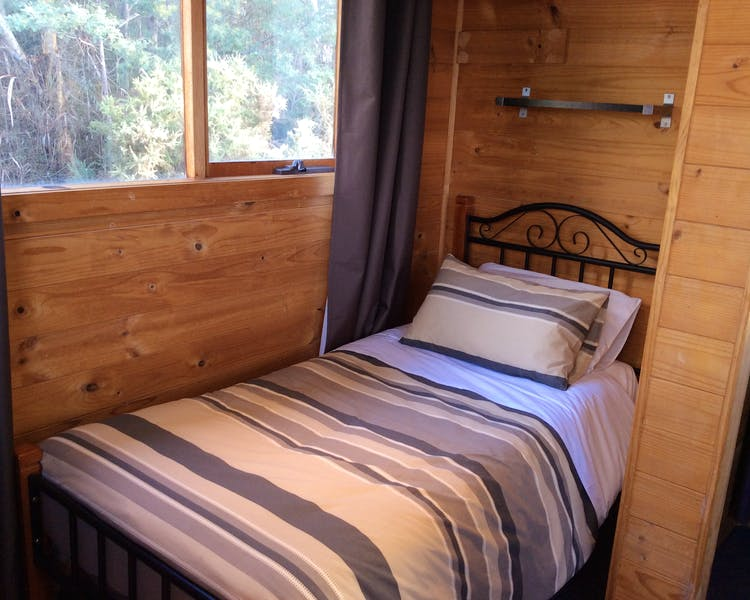 Single bed in Trappers Lodge self-contained house