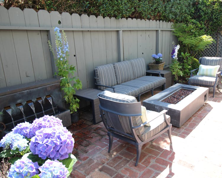 Patio area sitting area with fire table