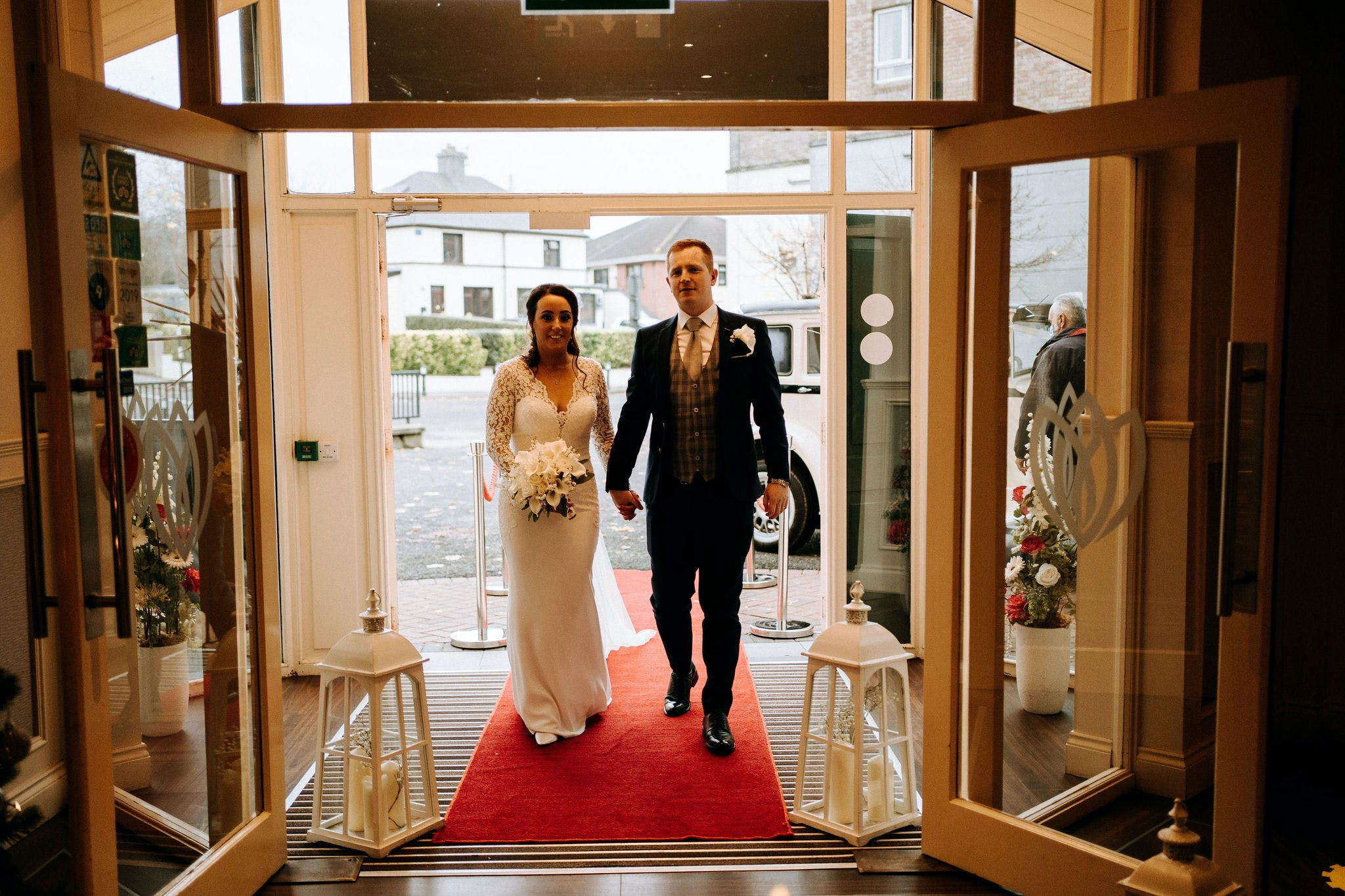 The bride and groom making their grand entrance at Riverside Hotel.