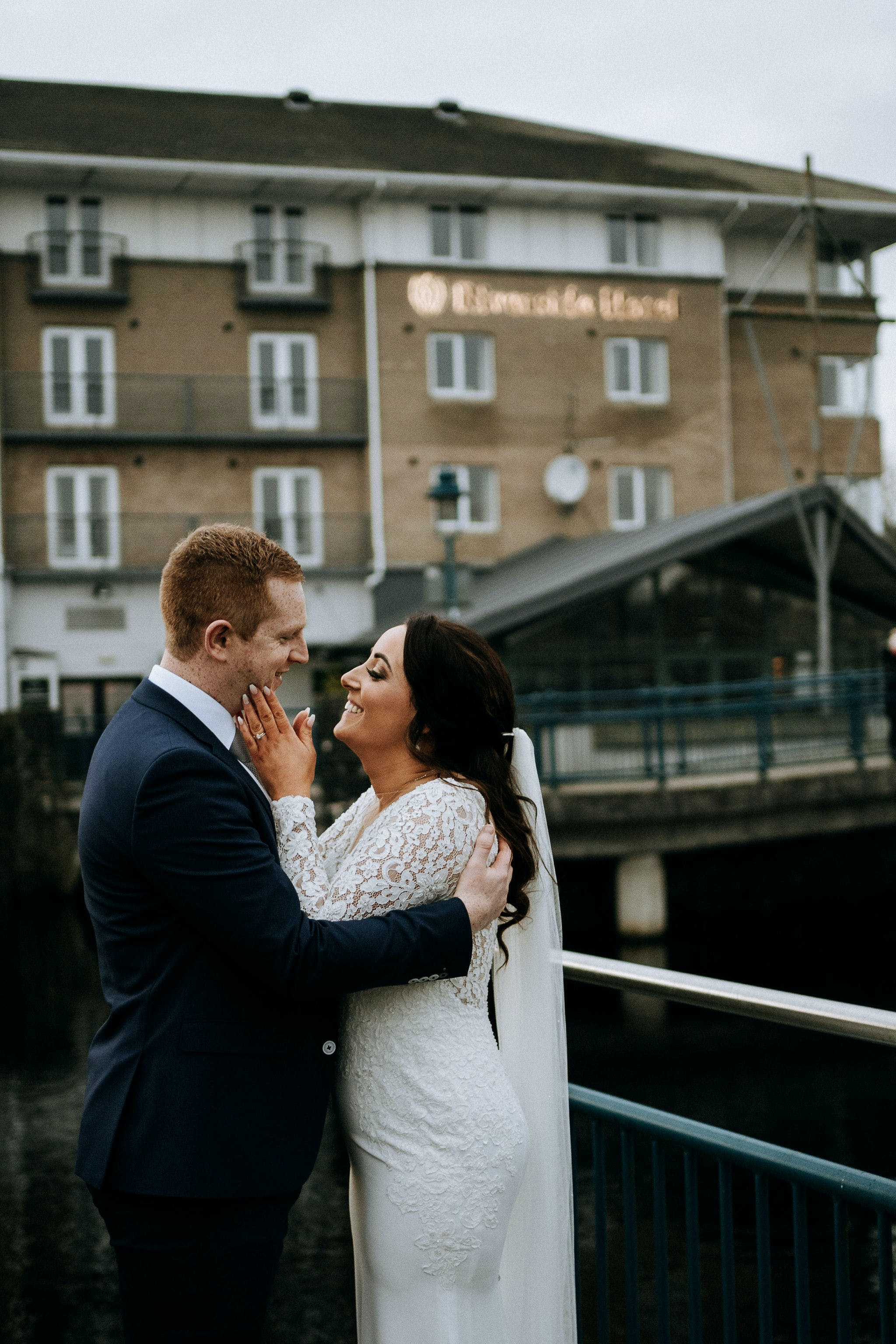 A tender moment between Nicole and Jason during their wedding at Riverside Hotel.