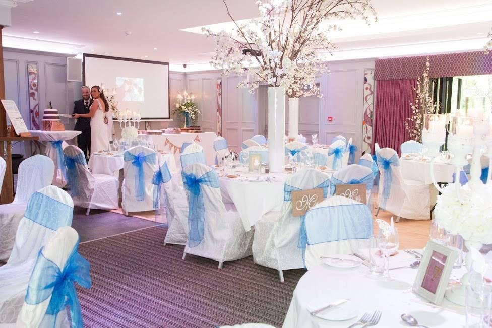 The Forde Room decorated with blue accents for Nicole and Jason's wedding at Riverside Hotel.
