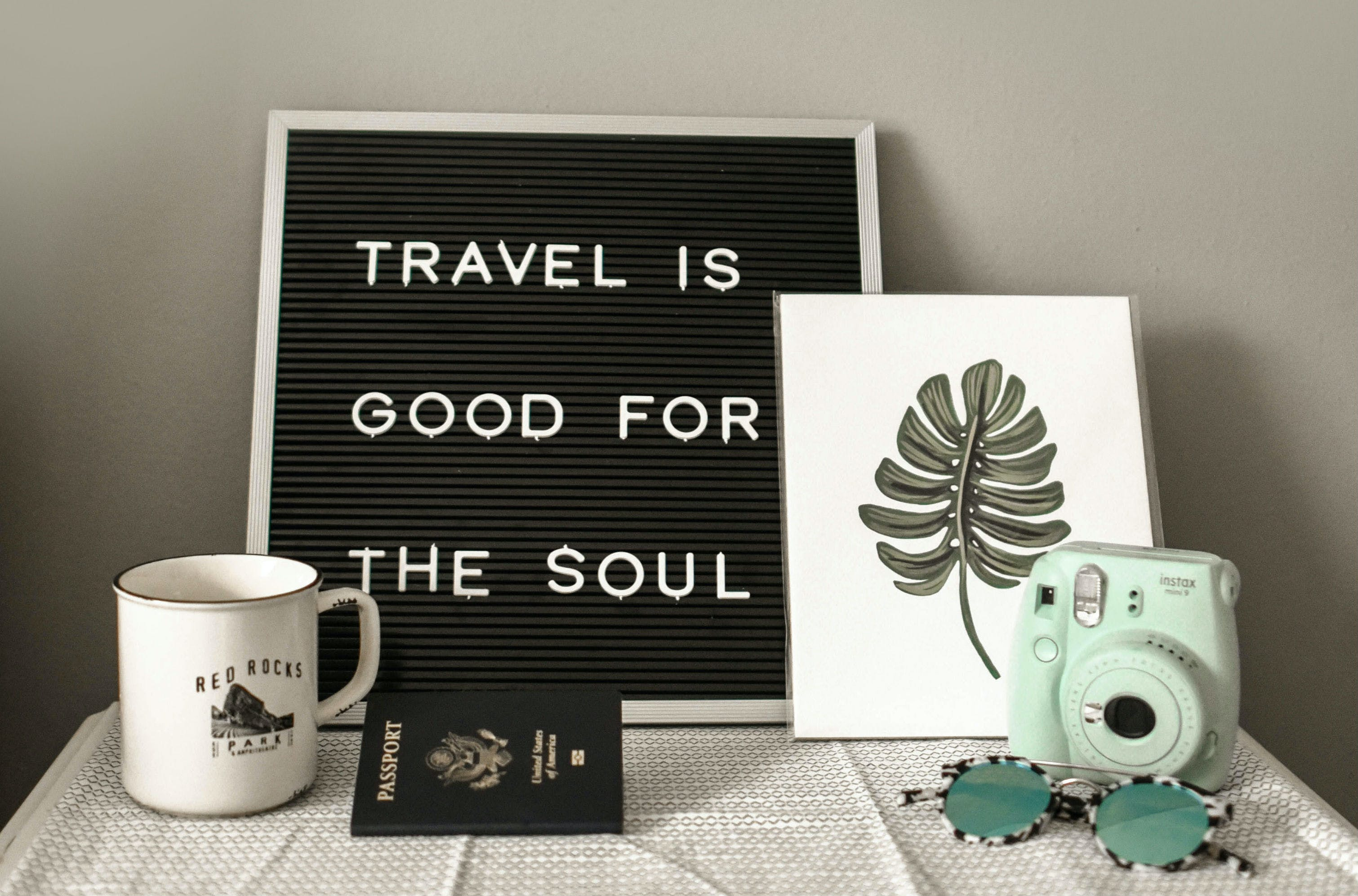 "signage of ""travel is good for the soul"""