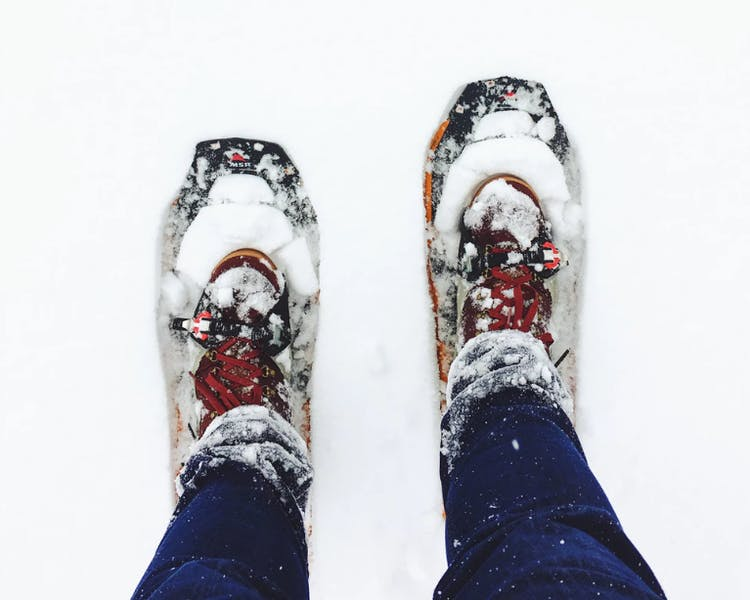 Image of snow boots covered in snow.
