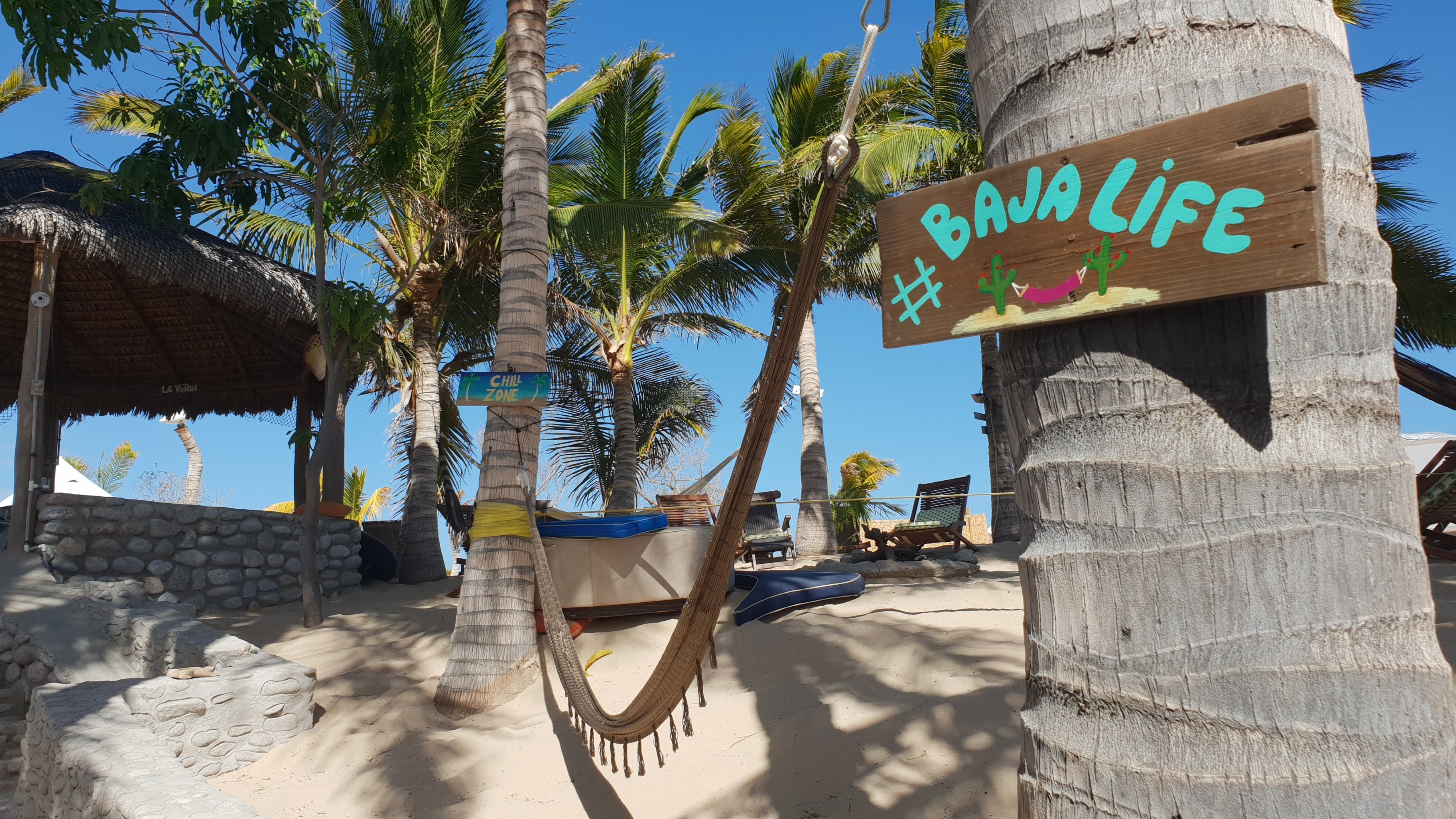 Property on a beach with palm trees and hammocks in La Ventana.