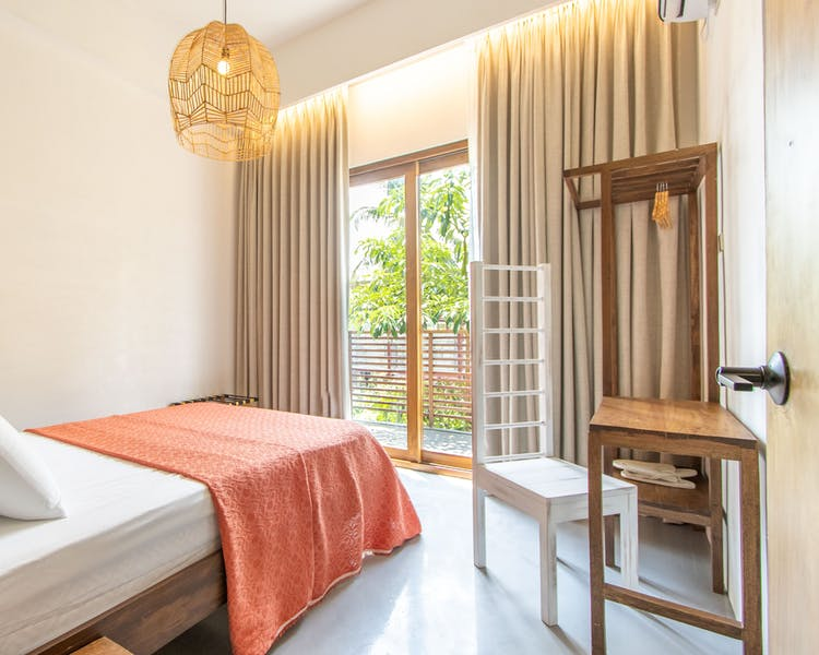 Premium Double Bed with Balcony inside Kaza Boutique Hotel in Siargao Island