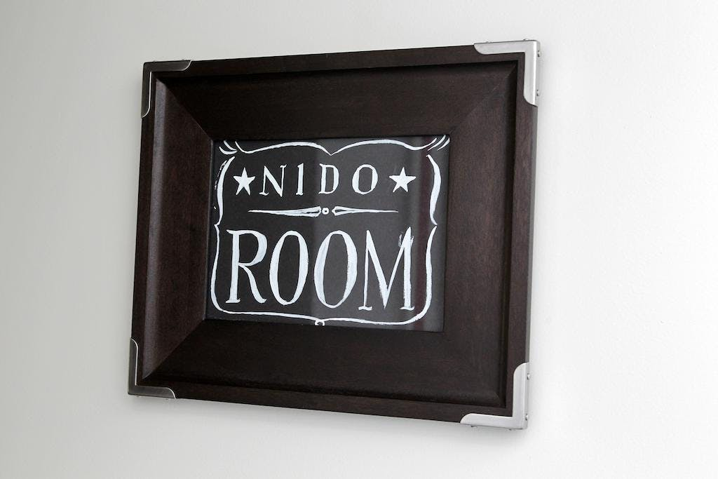 Junior Suite Nido Room, logo