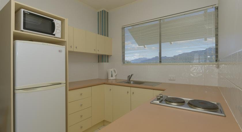 Retreat kitchenette with mountain backdrop.