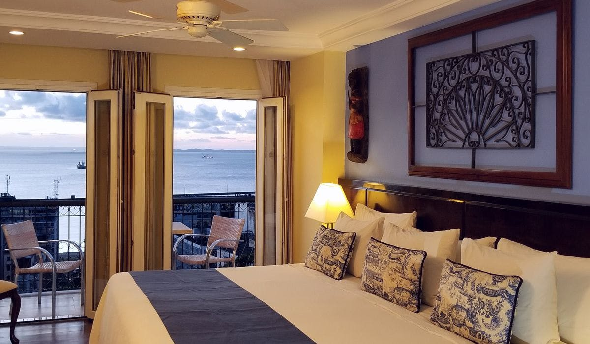 DeLuxe room inner view with bay view and varanda at sunset