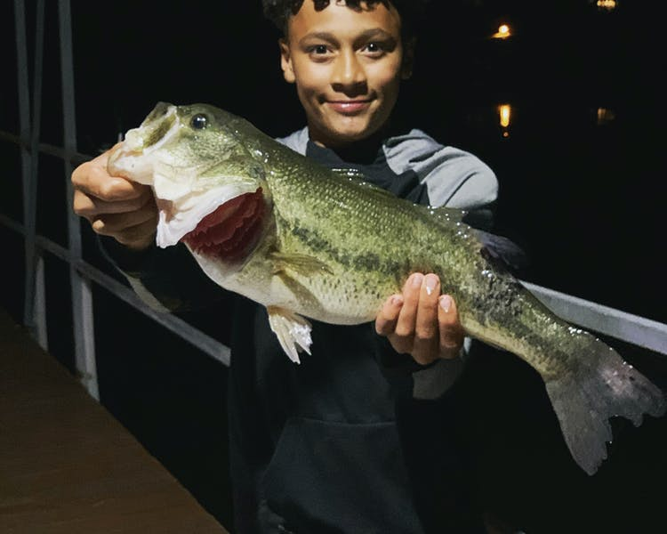 table rock lake fishing boy holding monster large mouth bass