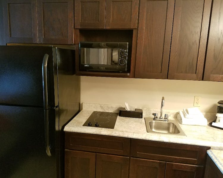 54 Extended Stay Suites with fridge & ice maker, two burner stove top, and microwave.