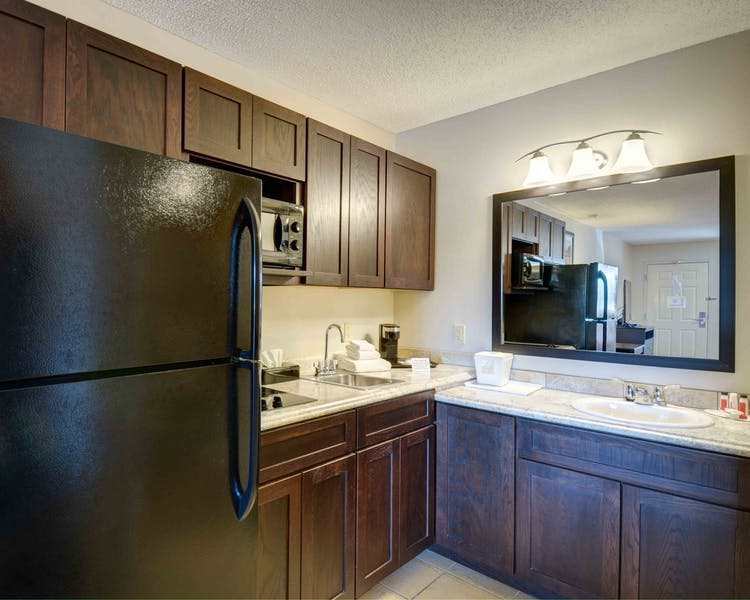 54 Extended Stay Suites with full size fridge with icemaker, two burner stove top, and microwave