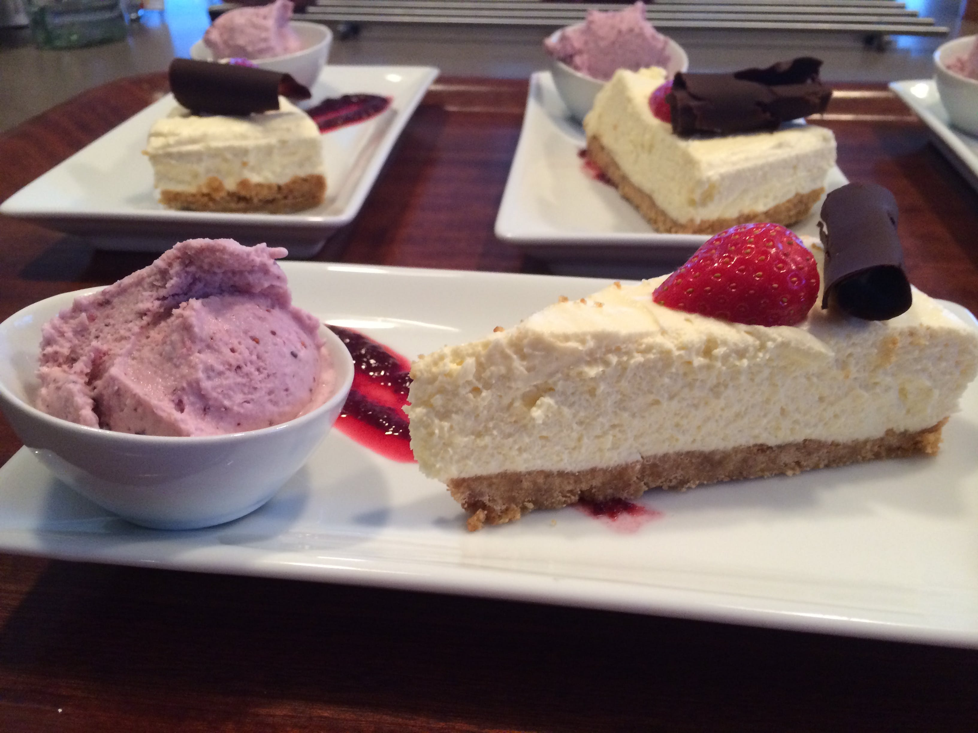 White chocolate cheesecake with homemade berry ice cream