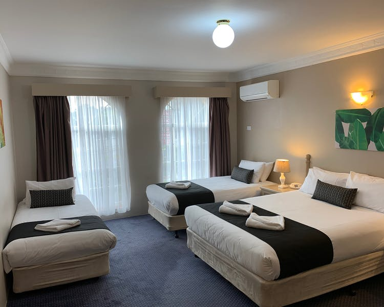 Family Room - One Queen & 2 Single Beds