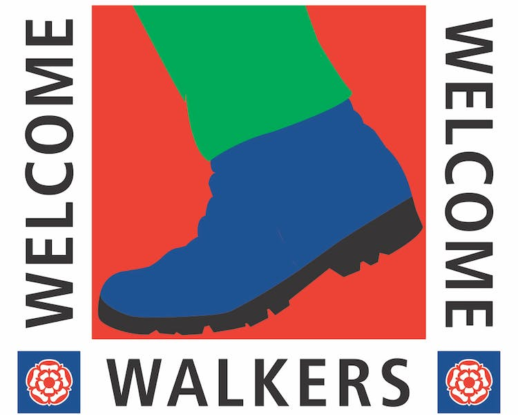 Walkers welcome logo for the Old Schoolhouse Bed and Breakfast in Haltwhistle, Northumberland