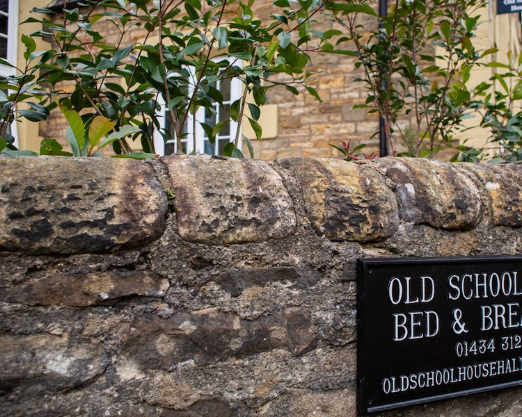 Street sign for the Old Schoolhouse Bed and Breakfast in Haltwhistle
