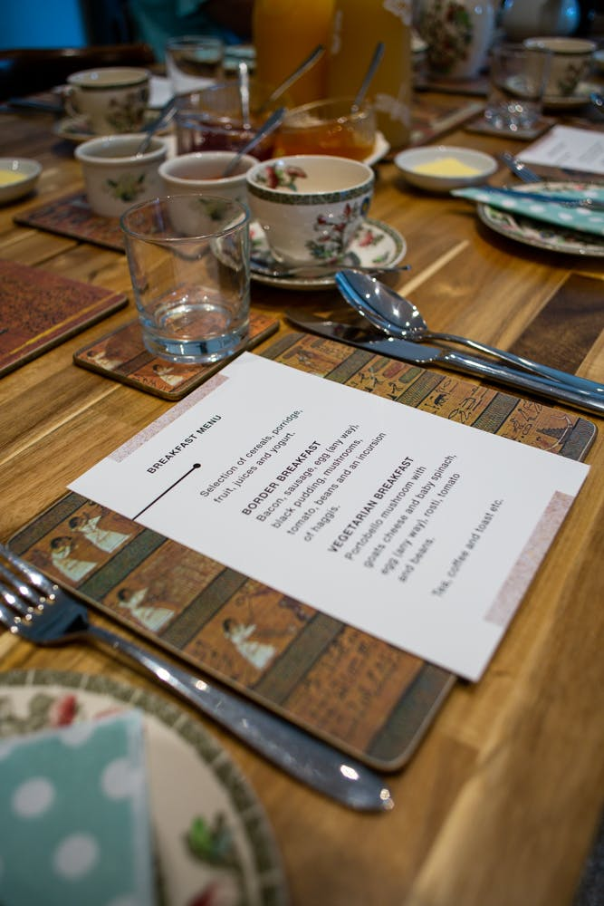 Dinner menu and place setting at The Old School House