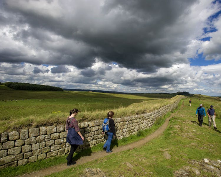 Groups of walkers along Hadrian's Wall near Haltwhistle, Northumberland