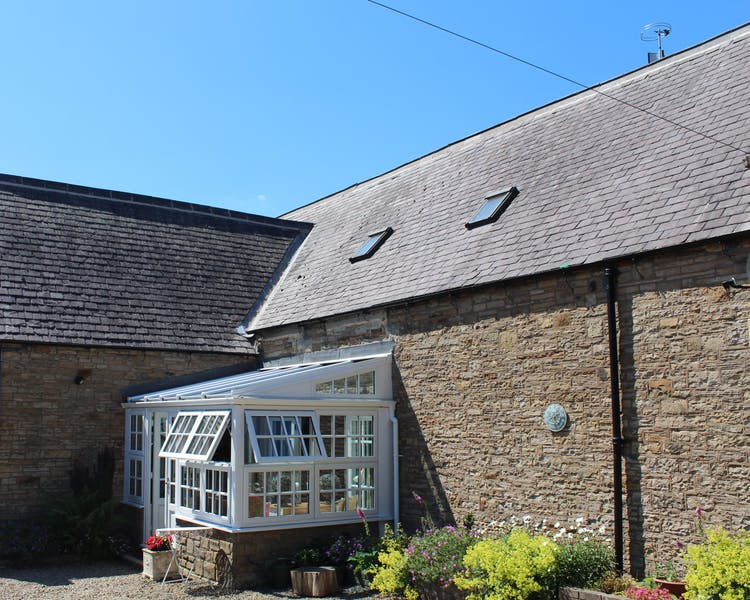 Exterior view of the sunroom at the Old Schoolhouse Bed and Breakfast in Haltwhistle, Northumberland