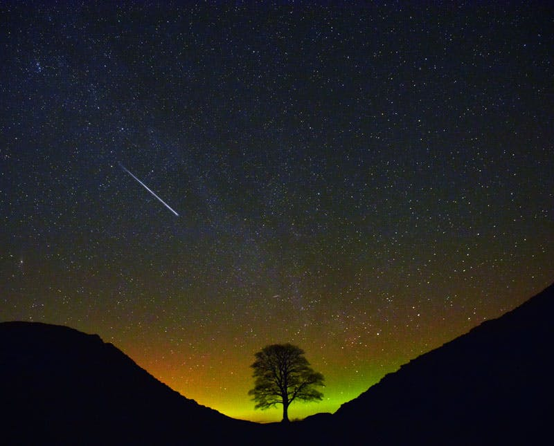 Sycamore Gap with night-time sky and comet.