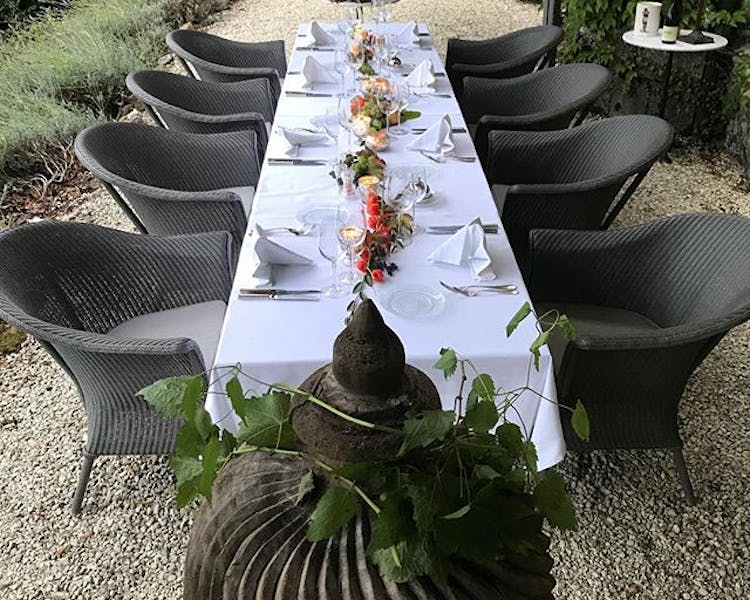 Summer dinner setting at Chateau Valcreuse at La Roche Posay