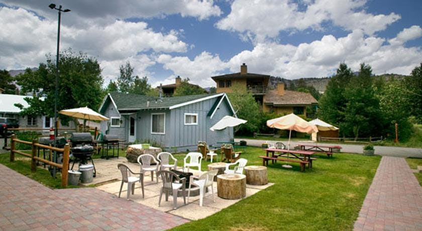 Courtyard view of communal campfire, grassed picnic area and the Main House
