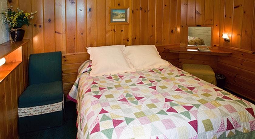 Queen bedded room in 1-bedroom cabin