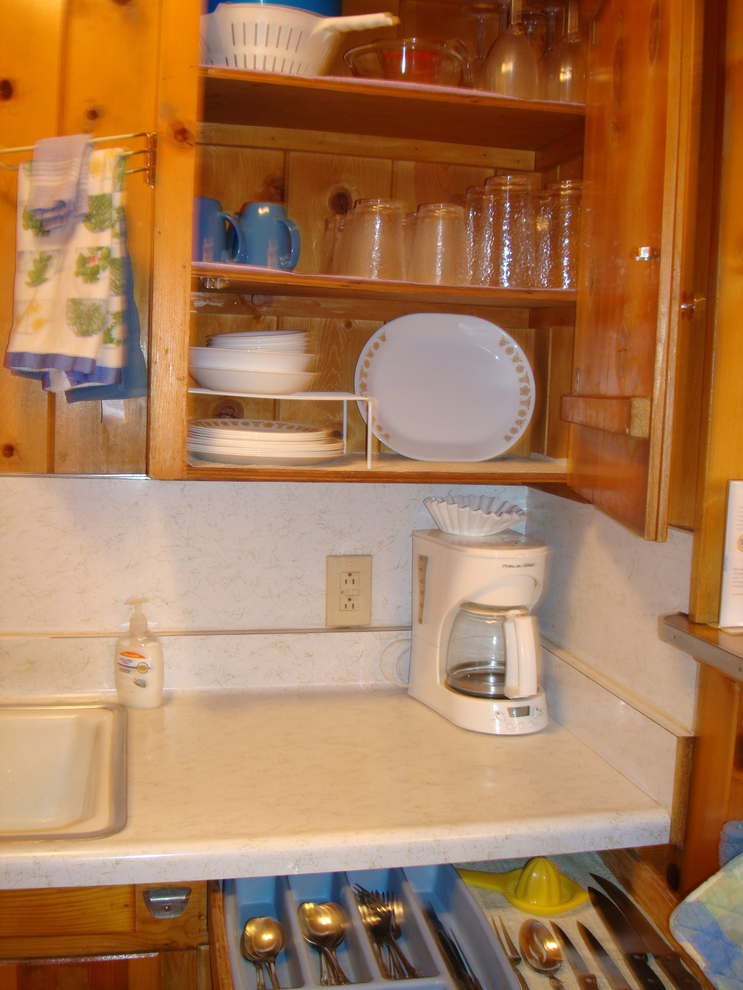 Kitchen cupboards in 1-bedroom cabin.