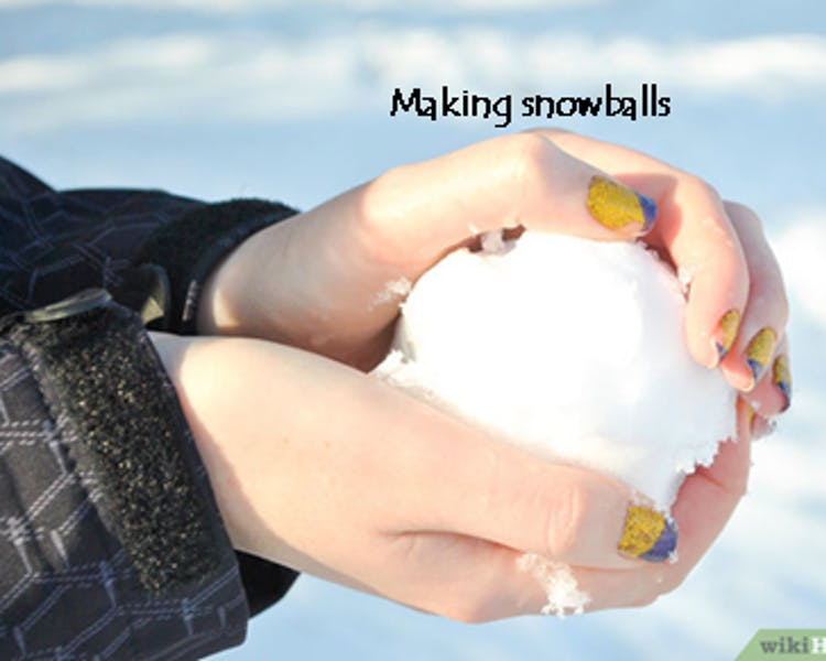 Making snowball in June Lake