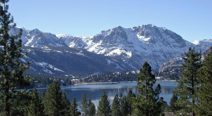 Beautiful June Lake with snow on Carson Peak.
