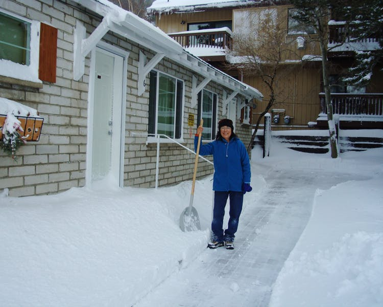 Laura shoveling the steps