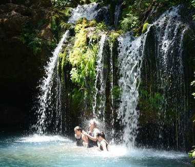 Swimming under the Ngare Ndare secret waterfalls.