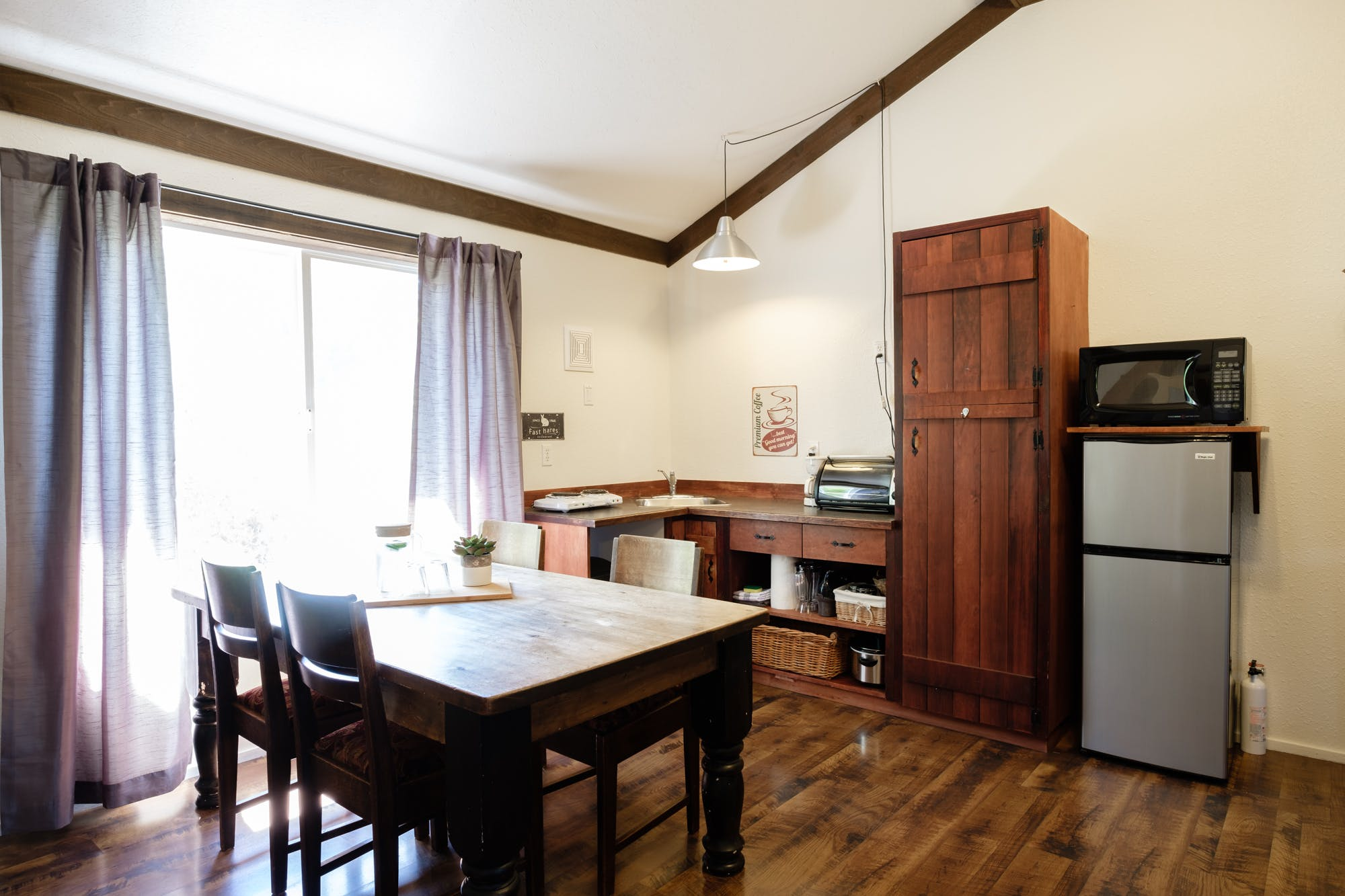 Kitchenette and dining area in Willow Cottage.