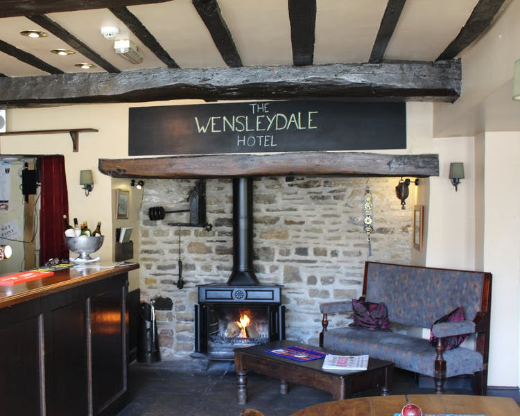 Open fire in the bar at The Tack Room Restaurant & Bar, boutique continental dining in Middleham, Yorkshire Dales,