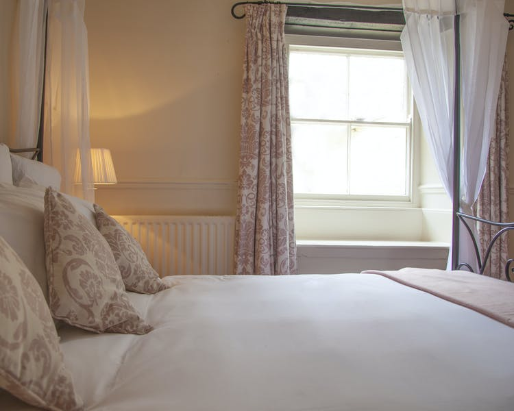 Four poster bed at The Wensleydale Hotel, Middleham, offers boutique accommodation in the heart of the Yorkshire Dales